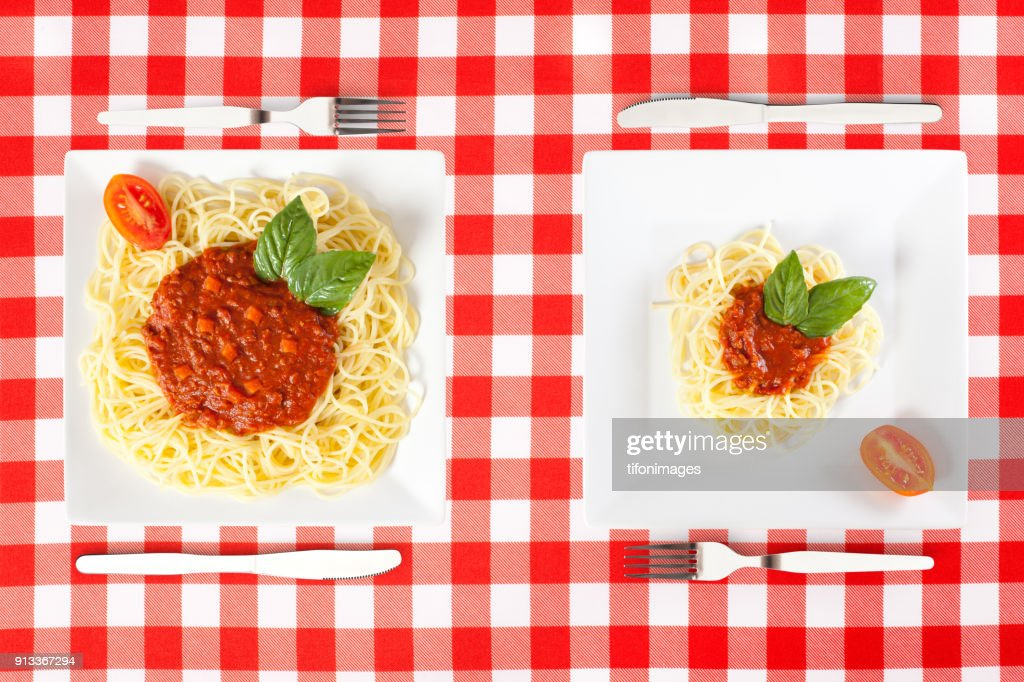 large and tiny food portions : Stock Photo
