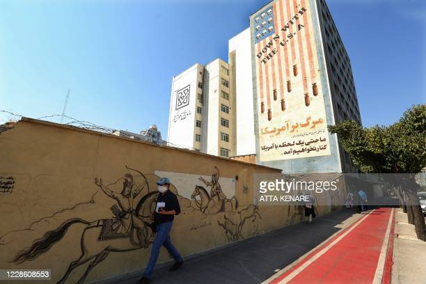 A large antiUS mural covers the wall of a building in the Iranian capital Tehran on September 20 2020 Iran called on the rest of the world to unite...