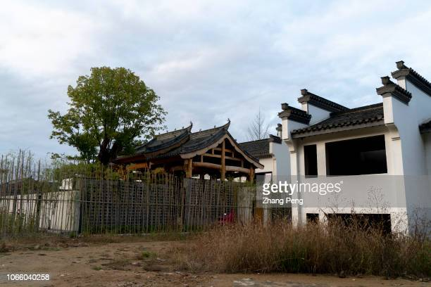Large area of unfinished villas on rural land are abandoned To take up uncultivated farmland and build holiday villas once a hot trend during the...