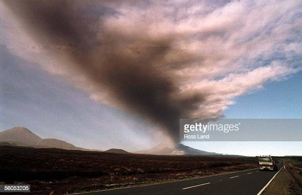 A large ash cloud hangs over the main highway as Mount Ruapehu continues to belch out ash after 24 hours of volcanic activity