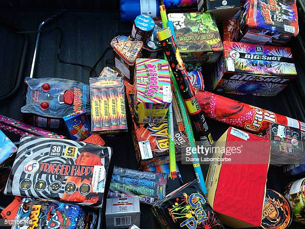 large assortment of fireworks piled together - box container stock pictures, royalty-free photos & images