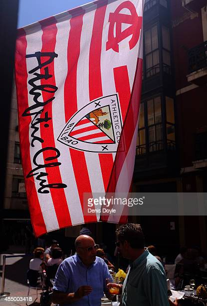 A large Athletic Club flag flies outside a bar in the Las Arenas district of Bilbao ahead of the La Liga match between Athletic Club and FC Barcelona...