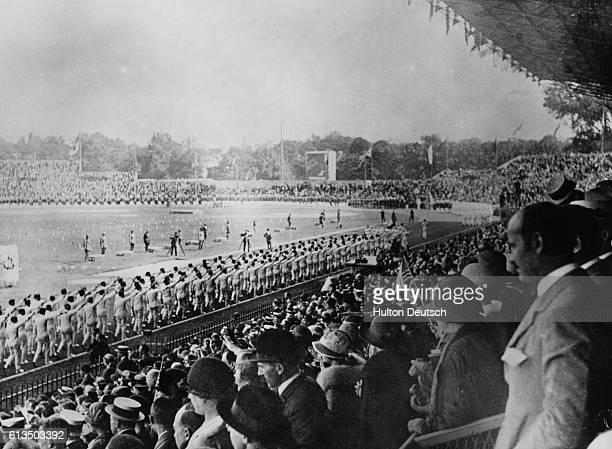 Large audience watches a ceremony at Colombes Stadium during the 1924 Olympiad at Paris, France. | Location: Paris.