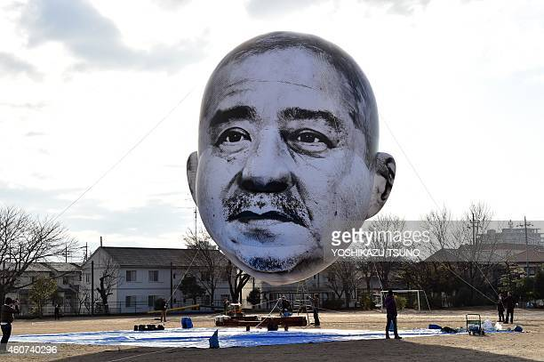 A large balloon of a face of 'ojisan' a middle aged man floats above the grounds of Nishiki elementary school in Utsunomiya in Tochigi prefecture...