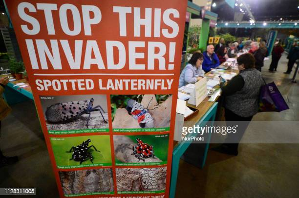 Large banner at the Philadelphia Flower Show information desk informs visitors about the invasive spotted lanternfly as the annual event draws...