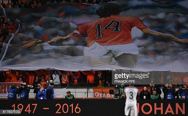 A large banner is displayed during a standing ovation in honour of late Dutch football legend Johann Cruyff during a pause in the 14th minute of the...
