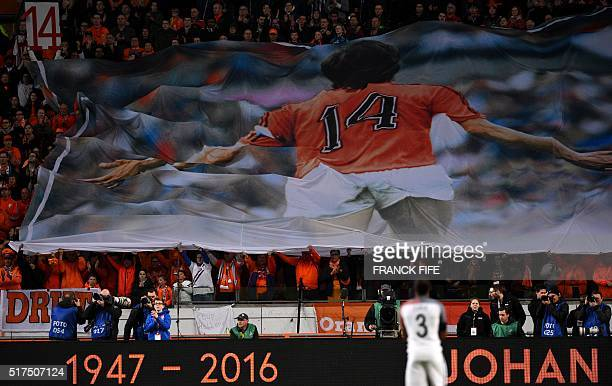 Large banner is displayed during a standing ovation in honour of late Dutch football legend Johann Cruyff during a pause in the 14th minute of the...