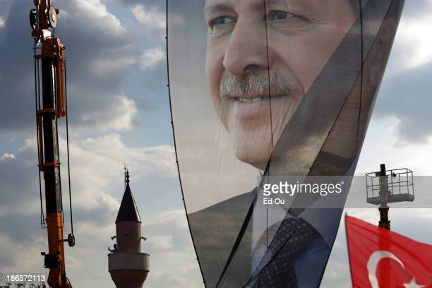 A large banner of Turkish Prime Minister Recep Tayyip Erdogan is seen in a progovernment rally in the Kazlçesme district of Istanbul Turkey on June...