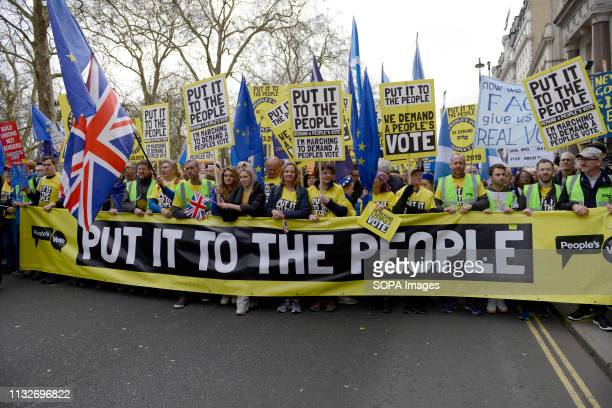 A large banner seen at the front of the protest Over a million people marched peacefully in central London in favor of a second referendum People...