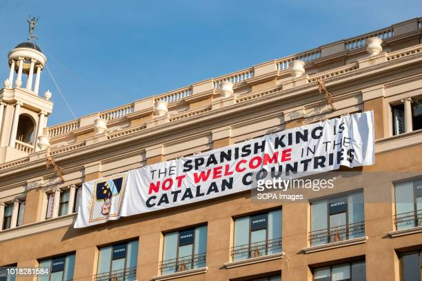 A large banner that rejects the visit of King Felipe VI is seen hanging on one of the buildings of Plaza Cataluna Barcelona celebrated the first...