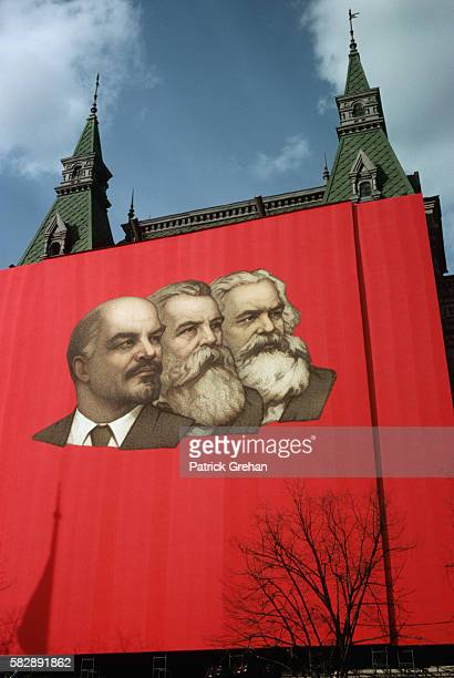 A large banner with portraits of Lenin Engels and Marx hangs in Red Square in Moscow on May Day 1975