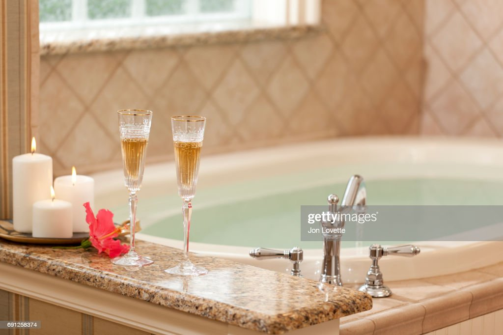 Large Bath Tub With Two Glasses Of Champagne Stock Photo | Getty Images