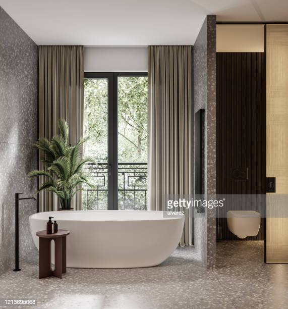 large bathroom with a bathtub - domestic bathroom stock pictures, royalty-free photos & images