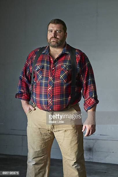 Large Bearded Man in Suspenders