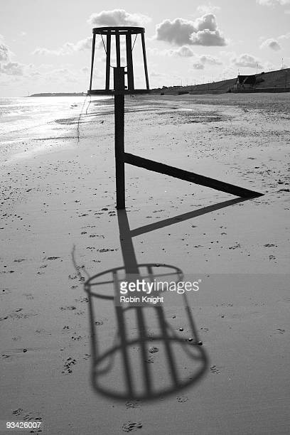 Large bell shadow on beach