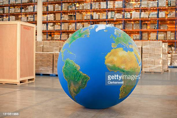 Large big blue ball in warehouse