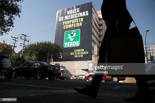 A large billboard advertisement for the Partido Verde Mexico's Green Party stands over a parking lot in Mexico City Mexico on Tuesday Feb 24 2015...
