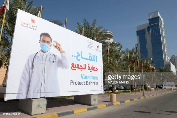 Large billboard carries a message encouraging people to take part in a voluntary free vaccination campaign against COVID-19 outside the Bahrain...