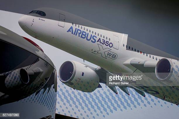 A large billboard of the Airbus A350 XWB on the side of the Airbus corporate chalet at the Farnborough Air Show England The A350 XWB is the only...
