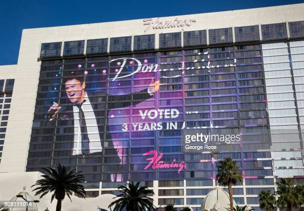 A large billboard on the side of the Flamingo Hotel Casino promoting the Donny Marie Osmond show is viewed from The Strip on March 2 2018 in Las...