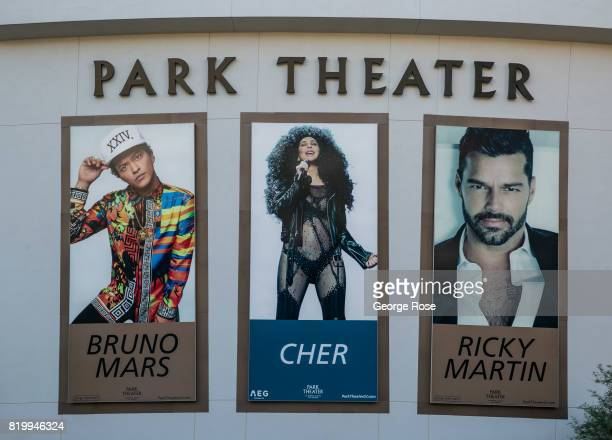 A large billboard promoting Bruno Mars Cher and Ricky Martin concerts at the Park Theater located adjacent to the Monte Carlo Hotel Casino is viewed...