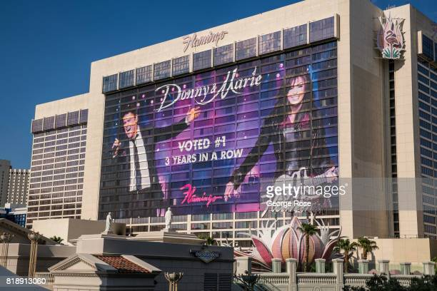 A large billboard promoting the Donny Marie Osmond show on the side of the Flamingo Hotel at the corner of Flamingo Road and Las Vegas Blvd is viewed...