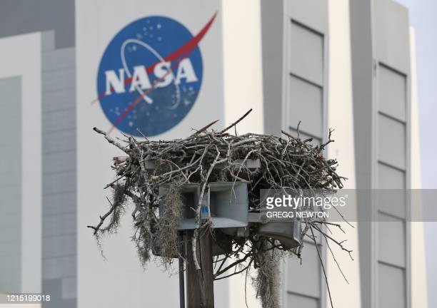 A large bird nest adorns a utility pole near the Vehicle Assembly Building at the Kennedy Space Center in Florida on May 26 2020 NASA astronauts Bob...
