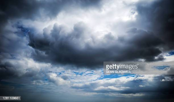 large black cloud - weather stock pictures, royalty-free photos & images