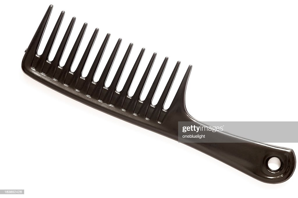A large black comb on a white background : Stock Photo