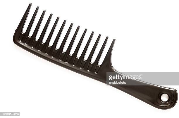 A large black comb on a white background