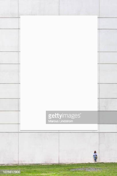large blank billboard on a wall - vertical stock pictures, royalty-free photos & images