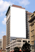 Large blank billboard on the side of a city building