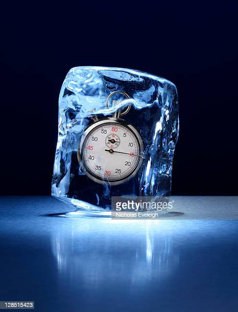 Large block of ice with a stopwatch frozen inside