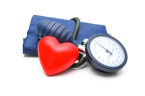 Large blood pressure gauge with a red heart leaning on it 454983987
