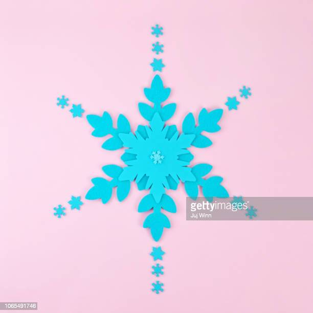 Large blue snowflake on pink background