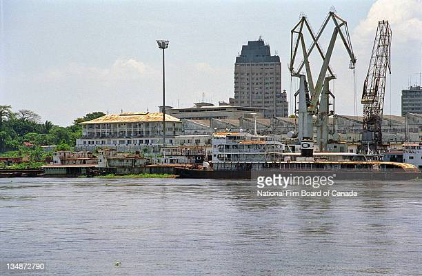 Large boat with cranes on a dock in Kinshasa, Democratic Republic of the Congo, 2003. Photo taken during the National Film Board of Canada's...