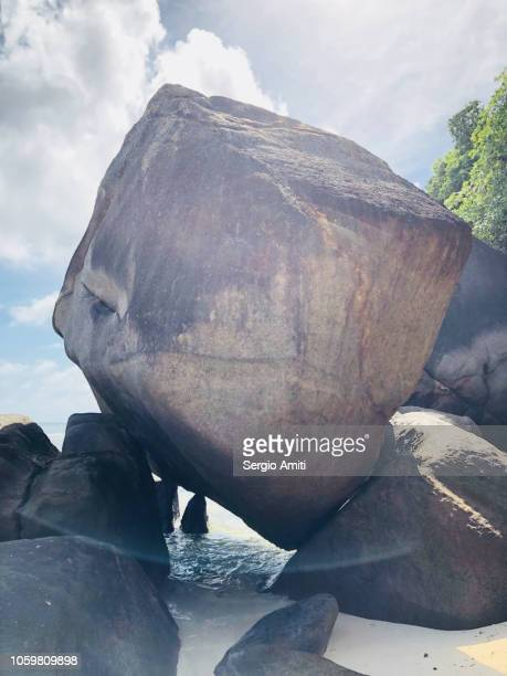 Large boulder on a beach in Seychelles