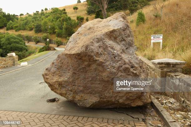 A large boulder rests on a road in Lyttelton on February 26 2011 in Christchurch New Zealand The death toll has risen to 145 and the hope for finding...