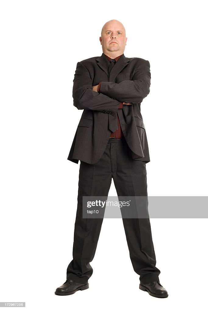 A large bouncer in a suit with his arms crossed : Stock Photo