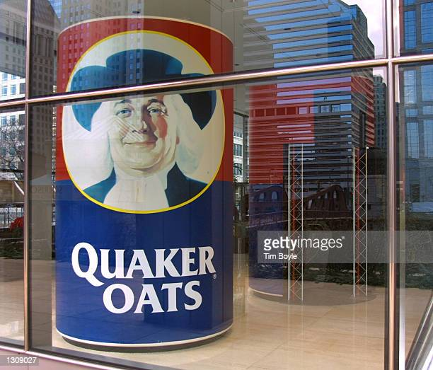 Large box of Quaker Oats is displayed in a first-floor lobby window December 4, 2000 at Quaker''s headquarters in Chicago. PepsiCo Inc. Has struck a...