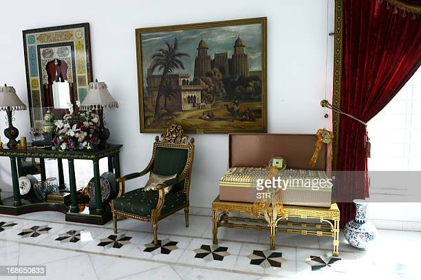 A large box of sweets rests on a chair and other furniture adorning a room inside Pakistan's incoming prime minister Nawaz Sharif's farm house in...