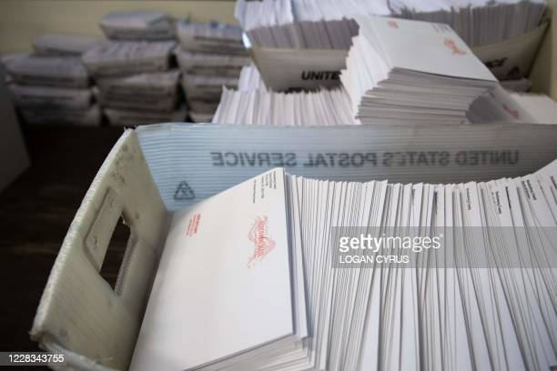 Large boxes of envelopes are seen as absentee ballot election workers stuff ballot applications at the Mecklenburg County Board of Elections office...