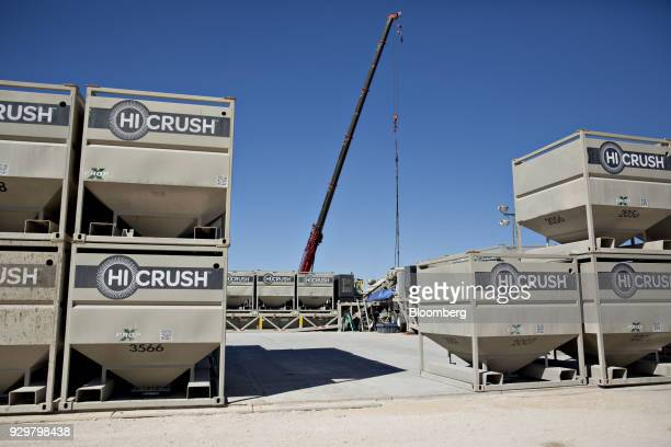 Large boxes of frac sand sit in stacks near six Chevron Corp oil wells being readied for hydraulic fracturing in the Permian Basin near Midland Texas...