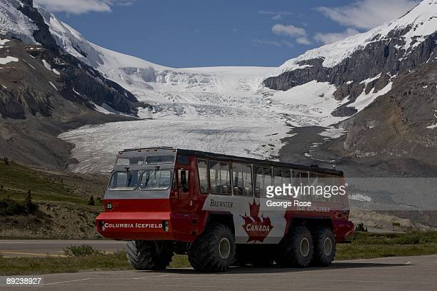 A large Brewster allterrain tour bus with the Columbia Glacier in the background is seen in this 2009 Jasper National Park Alberta Canada summer...