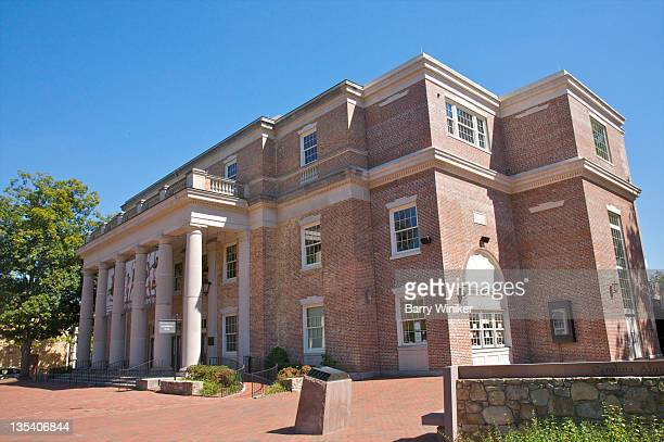Large brick three-story building with columns