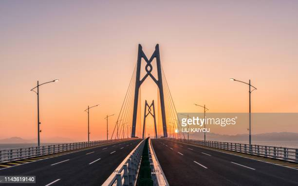 large bridge with beautiful sunset - guangdong province stock pictures, royalty-free photos & images