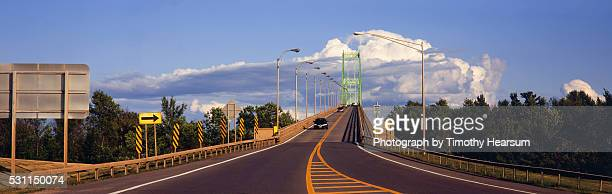 large bridge with clouds above - timothy hearsum stock pictures, royalty-free photos & images