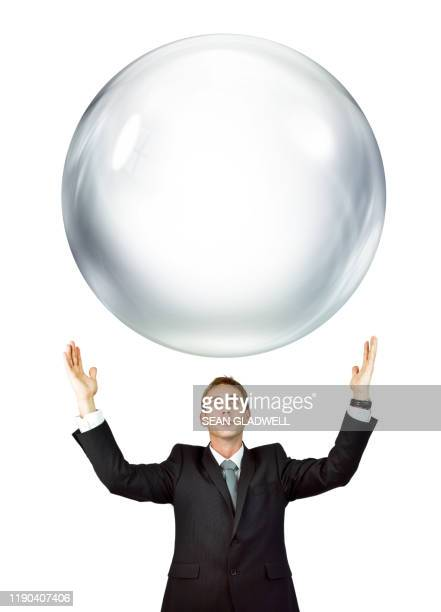 large bubble above businessman - bubble stock pictures, royalty-free photos & images