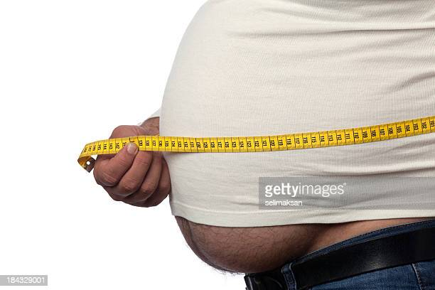 Large Built Man Measuring His Big Belly With Yellow Tape