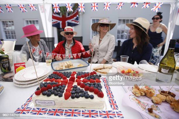 A large cake in the likeness of a Union flag also known as Union Jacks sits on a table during a street party to celebrate the wedding of Britain's...
